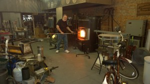 Hot Glass work in action.  Working the glass in the foundry.